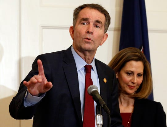 FILE - In this Feb. 2, 2019 file photo Virginia Gov. Ralph Northam, left, gestures as his wife, Pam, listens during a press conference in the Governors Mansion at the Capitol in Richmond, Va. Northam is actively campaigning for Democratic legislative candidates ahead of Election Day.