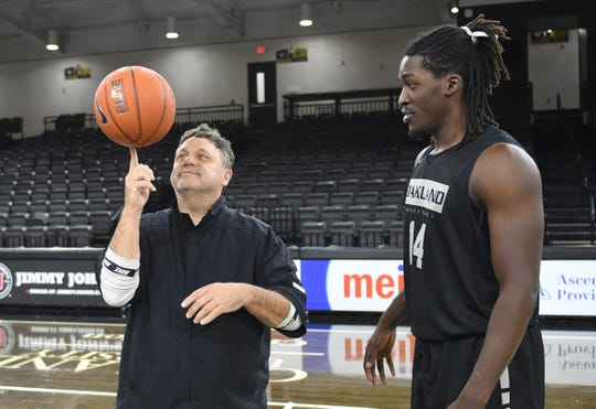 Oakland coach Greg Kampe shows off his skills with Xavier Hill-Mais.