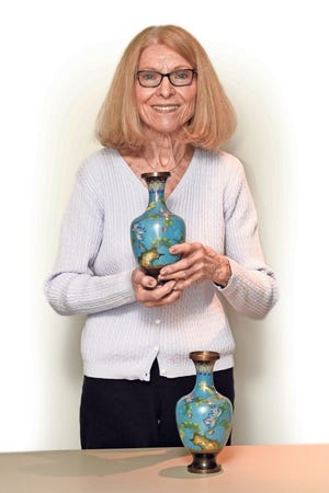 Valerie Panosian shows off a few vases, which were possibly made several decades ago .