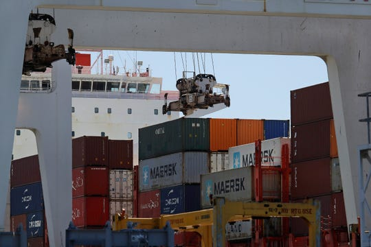 The Commerce Department reported that the July-September performance for the gross domestic product, the economy's total output of goods and services, was just below the 2% rate of growth in the second quarter.