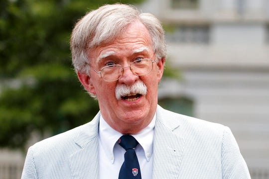In this July 31, 2019 file photo, National security adviser John Bolton speaks to media at the White House.