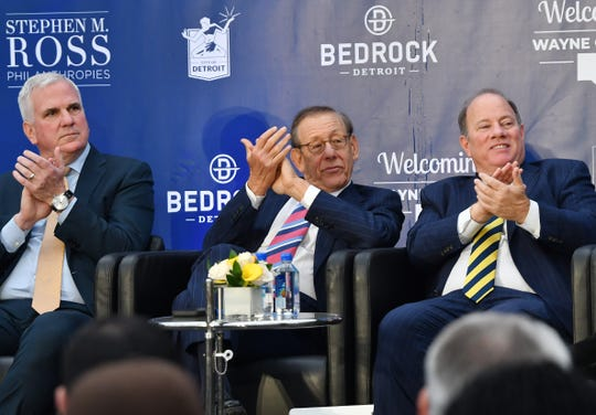 Matt Cullen, CEO of Bedrock, left, joins Stephen M. Ross and Detroit Mayor Mike Duggan in applause Wednesday for remarks by Councilwoman Janee Ayers.