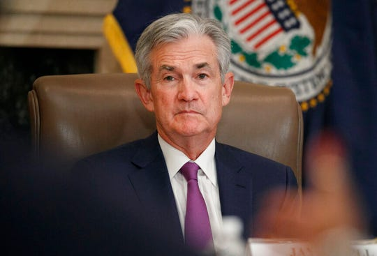 In this Oct. 4, 2019, file photo Federal Reserve Chairman Jerome Powell listens to feedback during a panel at the Federal Reserve Board Building in Washington. Federal Reserve officials reduced interest rates by a quarter-percentage point for the third time this year on Wednesday, Oct. 30, 2019.