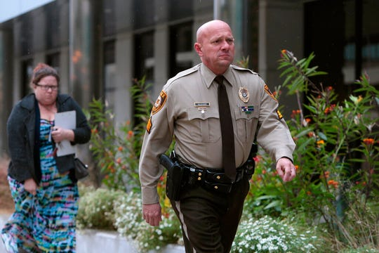 St. Louis County police Sgt. Keith Wildhaber returns from lunch break to the St. Louis County courthouse on the third day of his discrimination case against the county on Thursday, Oct. 24, 2019, in Clayton, Mo. Wildhaber, an Army veteran and a St. Louis County cop, alleges in a lawsuit filed in 2017 that he was passed over for promotion because he is gay and then retaliated against when he sought legal redress.
