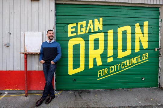 In this Monday, Oct. 28, 2019 photo, Seattle City Council candidate Egan Orion poses for a photo at his headquarters in Seattle.