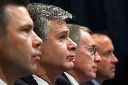 Acting Homeland Security Secretary Kevin McAleenan, left, FBI Director Christopher Wray, second from left, acting Director of the National Counterterrorism Center at the office of the Director of National Intelligence Russell Travers, second from right, and Department of Homeland Security undersecretary for intelligence and analysis David J. Glawe, right, wait to testify before the House Homeland Security Committee on Capitol Hill in Washington, Wednesday, Oct. 30, 2019, during a hearing on domestic terrorism.