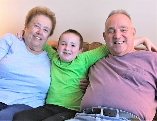 Jamison Root, 8, who lost his mother in 2014 and father in 2019, now lives with his maternal grandparents, Kay and Charles Lattimer of Athens Township.