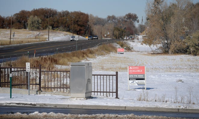 Signs advertise vacant lots for sale near the intersection of South College Avenue and Carpenter Road in Fort Collins, Colo. on Tuesday, Oct. 30, 2019. With little real estate available further north, developers are starting to look at space along South College Avenue.