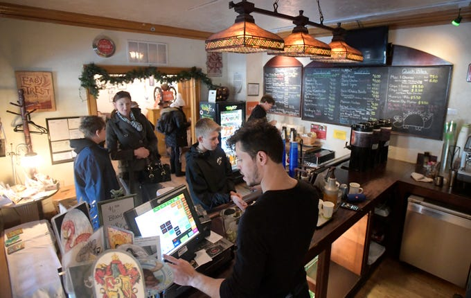 Customers wait in line during the last day of business at Wild Boar Cafe in Fort Collins, Colo. on Wednesday, Oct. 30, 2019.