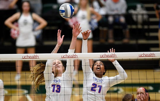 Colorado State's Kirstie Hillyer (13) and Colorado State's Jessica Jackson (21) go up for a block in the second set of the game against Wyoming at Colorado State University in Fort Collins, Colo. on Tuesday, Oct. 29, 2019.