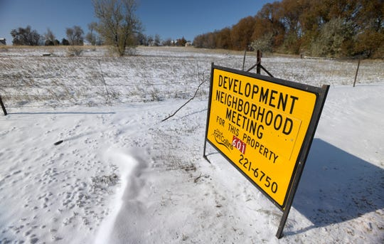 A sign notifies the public of a development neighborhood meeting for a vacant lot along South College Avenue in Fort Collins, Colo. on Tuesday, Oct. 30, 2019. With little real estate available further north, developers are starting to look at space along South College Avenue.