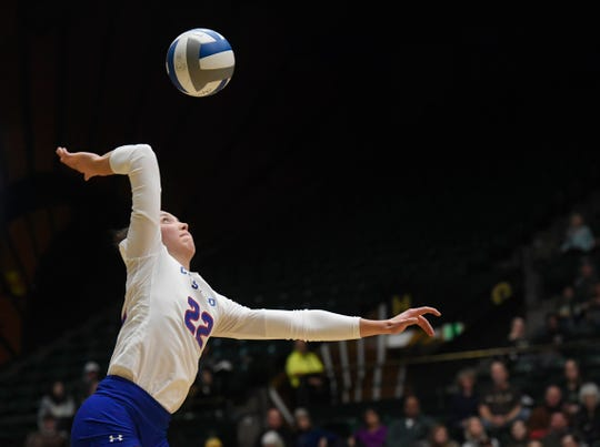 Colorado State's Katie Oleksak (22) serves in the fourth set of the game against Wyoming at Colorado State University in Fort Collins, Colo. on Tuesday, Oct. 29, 2019.