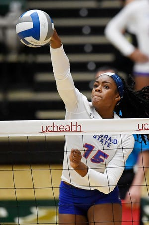 Colorado State's Breana Runnels (15) spikes the ball in the second set of the game against Wyoming at Colorado State University in Fort Collins, Colo. on Tuesday, Oct. 29, 2019.