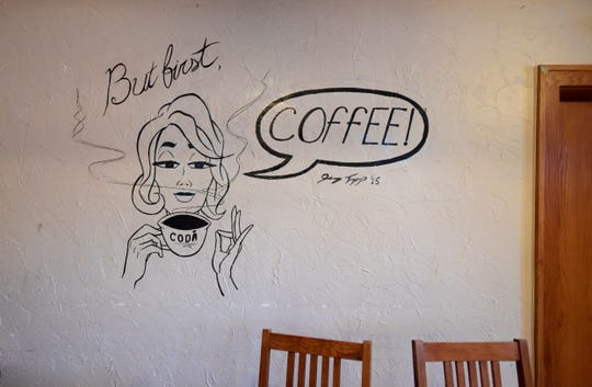 Wall art is visible downstairs during the last day of business at Wild Boar Cafe in Fort Collins, Colo. on Wednesday, Oct. 30, 2019.