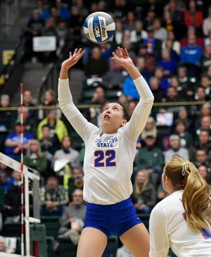 Colorado State's Katie Oleksak (22) sets the ball in the first set of the game against Wyoming at Colorado State University in Fort Collins, Colo. on Tuesday, Oct. 29, 2019.