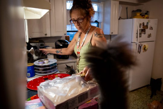 Tammy Nemec prepares breakfast for her rescue cats at her home in North Fort Myers on Wednesday, October 30, 2019.