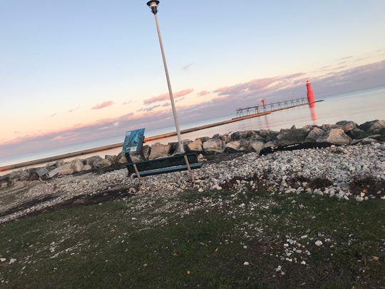 Rubble litters Christmas Tree Ship Point in Algoma after high winds and heavy waves pounded the Lake Michigan shore Oct. 21 and 22. The site was upgraded this summer with new plants, plaques and walkways and re-dedicated about a month before.