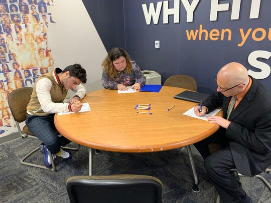 Applicants Yasin Jedir, left, and Eric Lecaptain, right, take the Foxconn aptitude test prior to interviews Wednesday, Oct. 30, 2019, at Northeast Wisconsin Technical College.