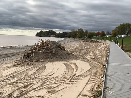 Mounds of debris await pickup Oct. 23 all along Crescent Beach in Algoma, where waves from unusually strong east-southeasterly winds winds off Lake Michigan threw driftwood, old tires and more onto the shore.