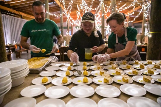 David Porras, co-owner and chef at Oak hill Cafe, Aaron Griffin and Lori Nelsen also co-owner, plate pumpkin tartar at the At the Table with The Greenville News: Chefs and Farmers event at Greenbrier Farms in Easley Tuesday, October 29, 2019.