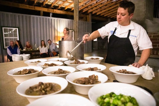 Shawn Kelly, chef at Fork and Plough restaurant in Greenville, ladles a stew into bowls at the At the Table with The Greenville News: Chefs and Farmers event at Greenbrier Farms in Easley Tuesday, October 29, 2019.
