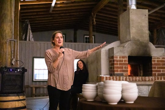 Amy Bishop, co-owner of Greenbrier Farms tells a story at the At the Table with The Greenville News: Chefs and Farmers event at Greenbrier Farms in Easley Tuesday, October 29, 2019.