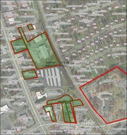 This Greenville County GIS map shows property owned by the city of Mauldin in the planned city center area highlighted in green. The Mauldin Cultural Center property is outlined in red to the right.