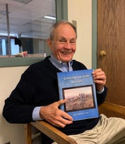 "John Stephenson-Love with his second book ""Growing up with Russell."""