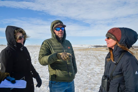 From left: D.D. Funderburk, president of Golden Triangle Chapter of Pheasants Forever, Chad Harvey, Pheasants Forever regional representative, and biologist Erin Fairbank look at the 280 acres the organization recently aquired on the Teton River north of Dutton, Wednesday, Oct. 30, 2019.