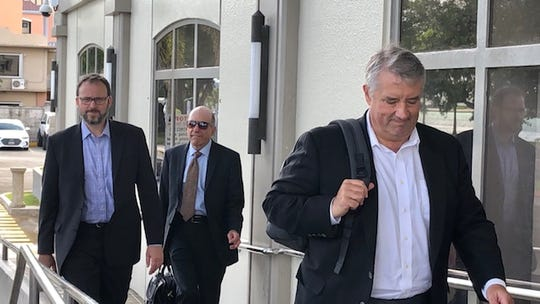 Minnesota-based attorney Edwin Caldie, left, and colleagues, representing clergy sex abuse survivors and other claimants in the Archdiocese of Agana's bankruptcy, arrive in federal court on Oct. 30, 2019 for a settlement conference.