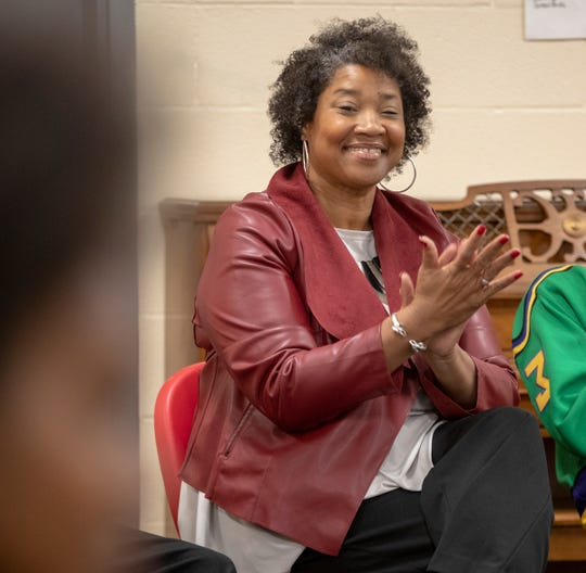 Val Tate, community engagement and development director, listens to one of the young people in attendance during a session for Community Action of Greater Indianapolis and YES Indy, Monday, October 21, 2019. The organizations partnered for a nine-week workforce development training for 30 Indianapolis youth and young adults.