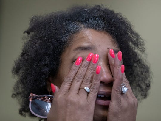 Val Tate wipes away tears as she talks with a reporter about the mentoring she does, Indianapolis, Friday, Sept. 6, 2019. The program helps out young men living in several local zip codes hardest hit by poverty.