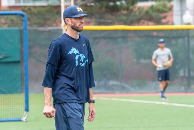 Michigan Wolverines pitching coach Chris Fetter looks on during team practice at Creighton University.