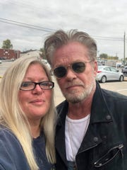 John Mellencamp poses with Pamela Bliss Tuesday afternoon in Seymour.