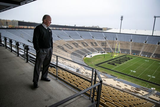Purdue University president Mitch Daniels looks onto Ross-Ade Stadium from a pavilion balcony in West Lafayette, Ind., Tuesday, Oct. 29, 2019. Daniels attends every Boilermakers home football game.