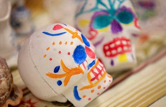 Items left for a Day of the Dead, or Dia de los Muertos celebration at Christ Church Cathedral, downtown Indianapolis, Wednesday, Oct. 30, 2019. This multi-family display is an example of this two-day uniquely Mexican holiday that honors lives lost.