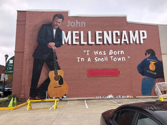 This John Mellencamp mural on the exterior of Seymour's This Old Guitar Music Store, 106 W. Second St., is nearly complete. Artist Pamela Bliss will finish painting the musician's jeans at right and add text commemorating Mellencamp's 2008 induction to the Rock and Roll Hall of Fame.