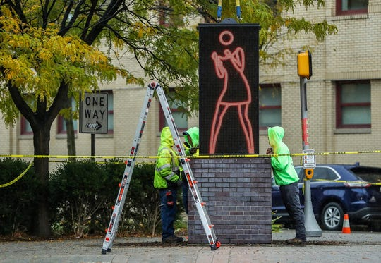"The new ""Ann Dancing"" electronic sculpture is installed by SignCraft Industries on Mass Ave in Indianapolis, Wednesday, Oct. 30, 2019. Donors raised more than $200,000 to the ""Keep Ann Dancing"" campaign to help pay for the iconic digital art piece by Julian Opie to be replaced by a structure with updated hardware and software."