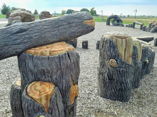 Younger climbers enjoy this portion of the North Liberty playground which offers a series of lower logs and stumps more in tune with their abilities.