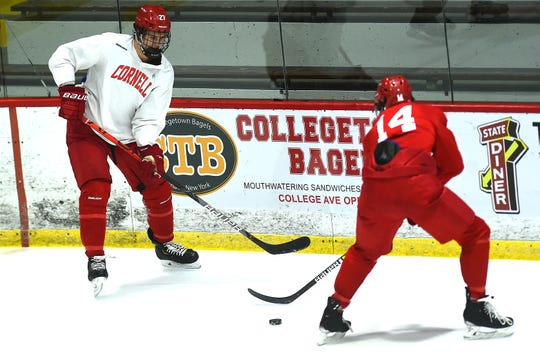 Morgan Barron (27) and Ben Tupker (14) Cornell University Big Red Hockey practice at Lynah Rink on Wednesday, October 29, 2019.