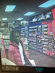 Police are looking to identify this man who is accused of making $7,000 worth of purchases using a stolen credit card.