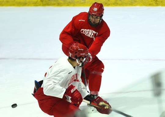 Peter Muzyka (2) and Jeff Malott (22), Cornell University Big Red Hockey practice at Lynah Rink on Wednesday, October 29, 2019.