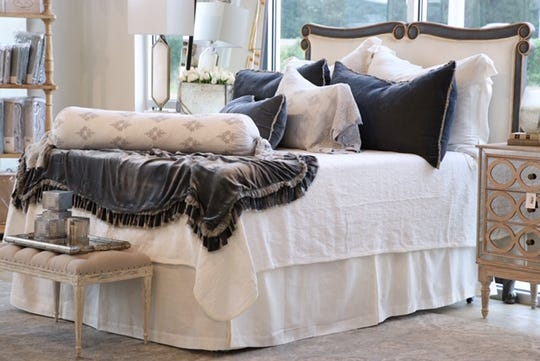 The new showroom of Relish showcases luxury bedding ensembles.