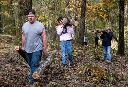 The Adamsville football players and coaches volunteer to help the community to clean up the trees from the storm, Saturday October, 26 after damaging many of the properties in the town. Ray Bright, Boyd Freeland, help move tree parts across the yard in their community in Adamsville, Tenn., Tuesday, Oct. 29, 2019.