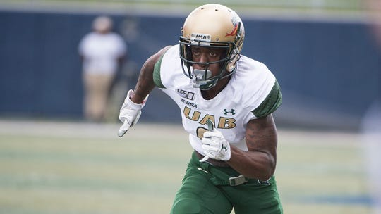 UAB receiver Austin Watkins starts his route against Akron on Sept. 7.