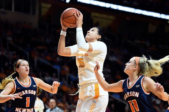 Tennessee's Jaiden McCoy (15) gets the rebound over Carson-Newman's Kayla Marosites (1) and Braelyn Wykle (11) on Tuesday, October 29, 2019.
