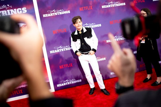 "Andy Mientus poses for a photo at the ""Dolly Parton's Heartstrings"" Netflix series red carpet premiere at Dollywood."