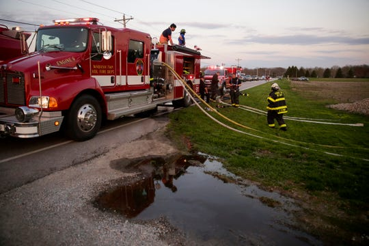 Firefighters from Wabash Township Fire Department work the scene of a structure fire on the 5300 block of Jackson Highway, Wednesday, April 17, 2019 in Wabash Township.