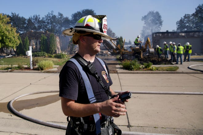Wabash Township Fire chief Ed Ward provides an update to the media after a fire destroyed five homes and severely damaged several others on Tesla Drive, Friday, July 12, 2019 in West Lafayette.