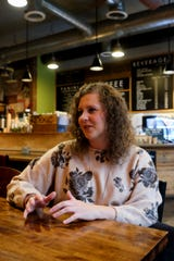 Cari Spaulding, 32, talks about her late father, Brad Spaulding, Wednesday, Oct. 30, 2019 in Lafayette. Spaulding left cards at several coffee shops around Lafayette and Indiana to buy people free coffee in honor of her dad.